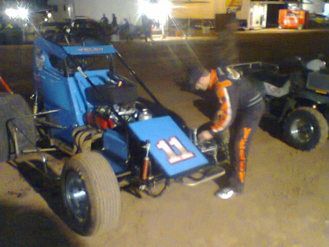 JJ working on his Sprint car ride before the A Main at Canyon Copper on Dirt