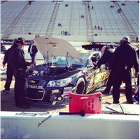 Team working on car after final practice