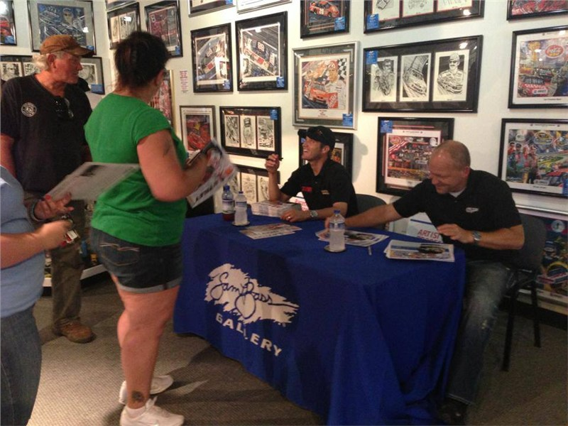 JJ and Sam Bass signing autographs at the Sam Bass Gallery