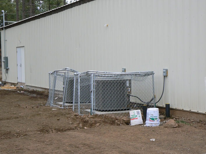 Destroying A/C Equipment Fencing
