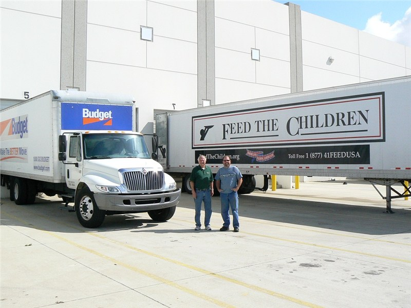 Doug and Rich picking up a donation from Feed the Children.