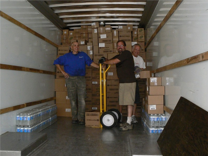 Bo, Rich and Doug are three hours into the unloading process… and still have enough energy to smile.