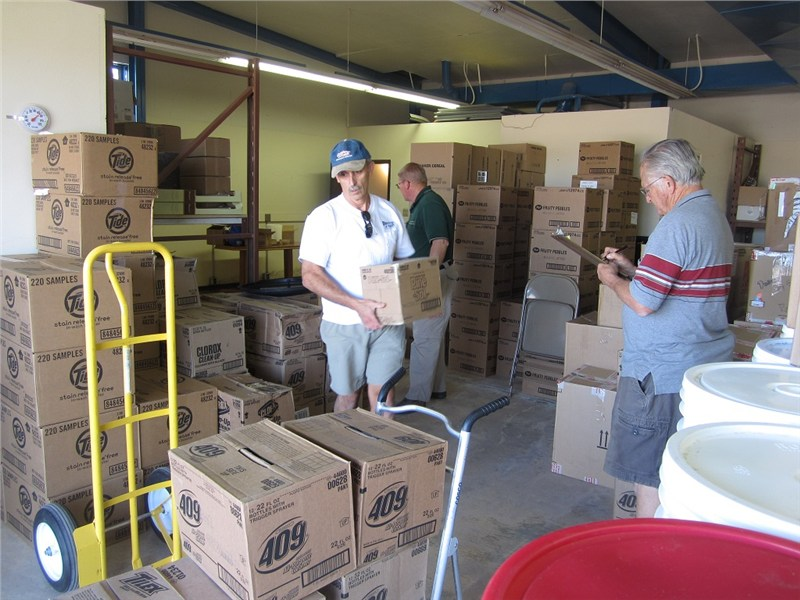 The distribution process starts… Jim loads and Doug inventories supplies being loaded for the Assembly of God Church in Houck AZ.