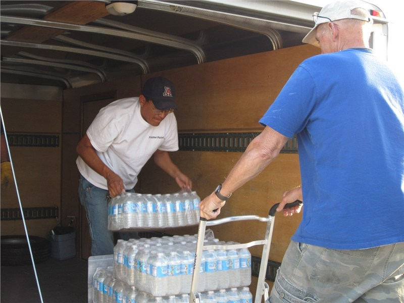 Solomon (First Presbyterian) and Bo unloading the last of the water supplies.