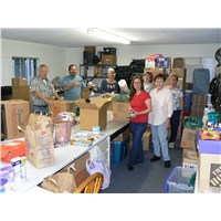 Members of the Operation 29:11 team preparing donations for delivery in our very crowded work room at Magnolia Baptist Church in Anaheim CA.