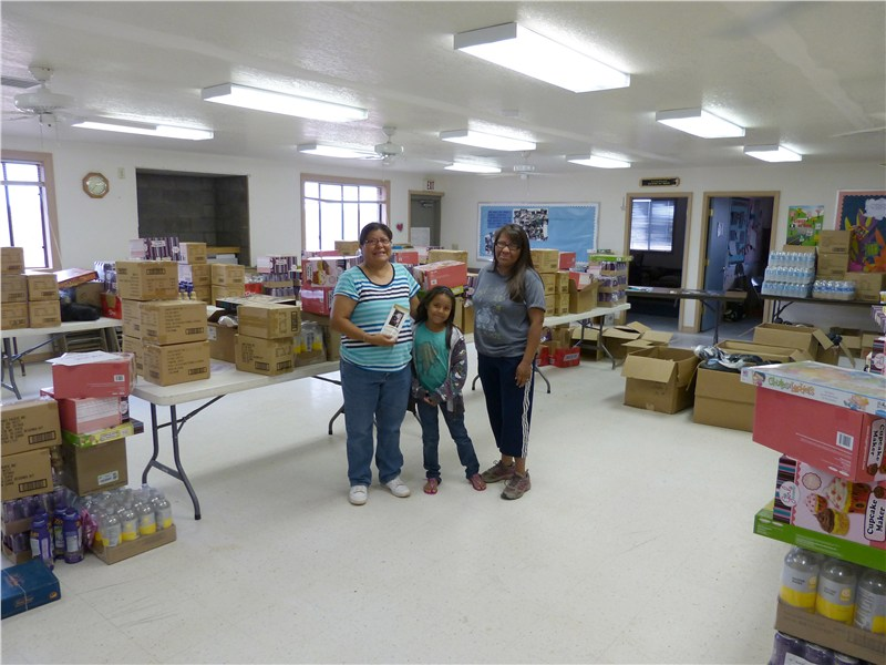 Three ladies of FPCL after they organized the supplies for distribution… which began within hours of our delivery