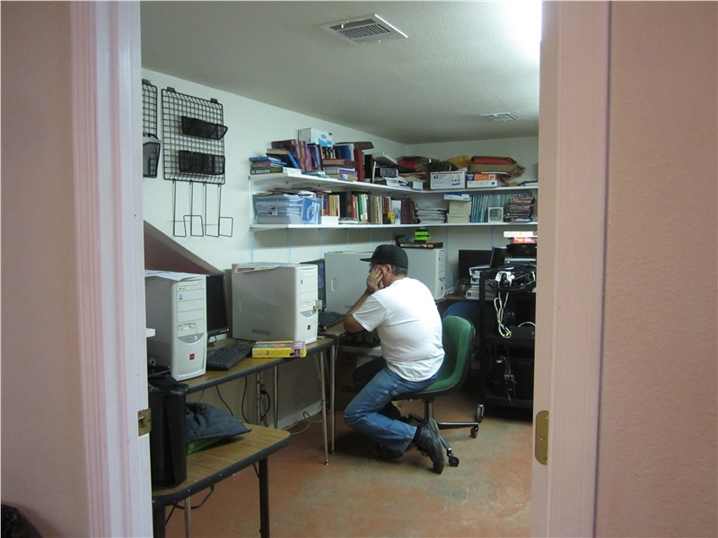 Rich checking the three computers he replaced at McNary Apache Baptist Church