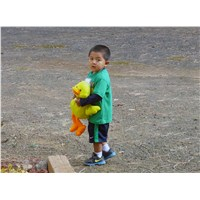Pastor Jack Townsend's grandson and his new duck at McNary Apache Baptist Church