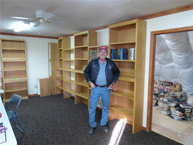 Pastor Stan Patterson… new bookshelves are arriving at Pure Heart…