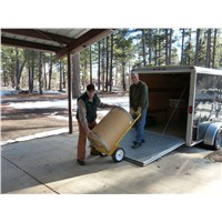 Pastor Jack Townsend and Jim Yost unloading 350 lbs. of soup mix