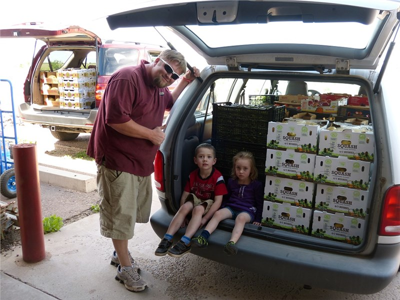Michael and the kids with vehicles loaded and ready to deliver