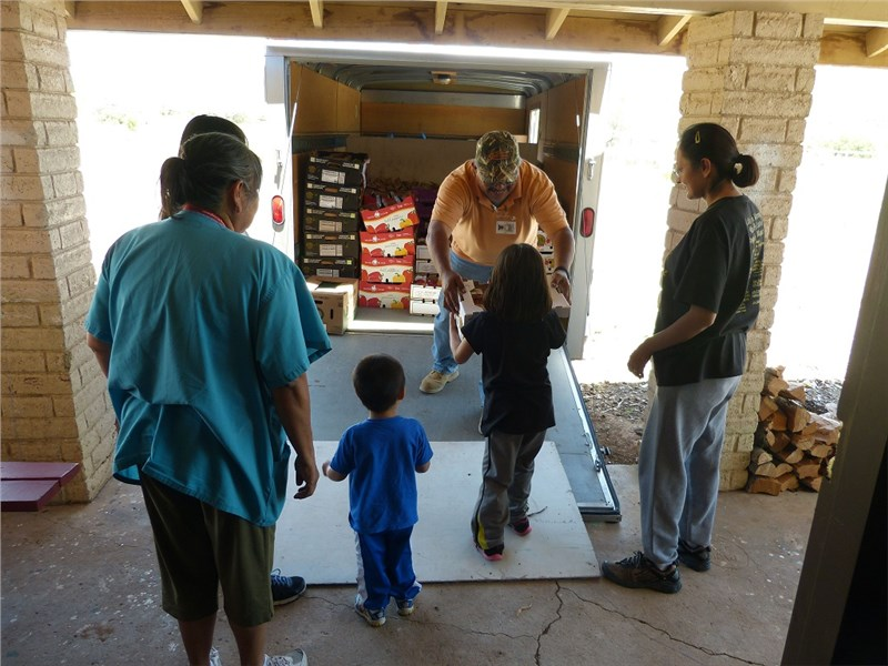 Veldon and the Fort Apache Hope Center unloading team