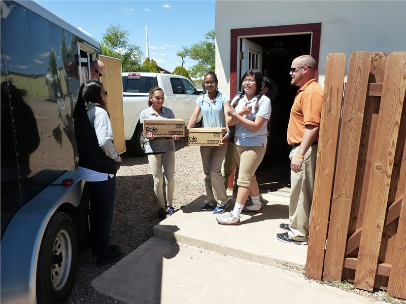 Native American Christian Academy students helping Randy unload food provided by our partners Feed The Children and Giving Children Hope.