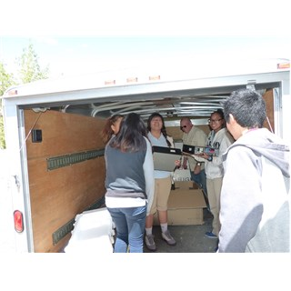 Native American Christian Academy students helping Randy unload twenty refurbished computers to update their computer lab. Operation 29:11 provided the original computers still in operation in 2007. The new replacements were provided by our partner Nat Miller and Heroes Deserve Help.