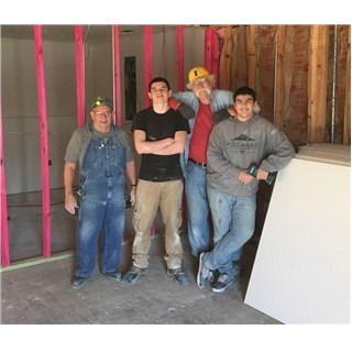 Gary and his grandsons are dry walling the Nehemiah's Vision job control office at The Mission Center of First Baptist Church Vidor, Texas