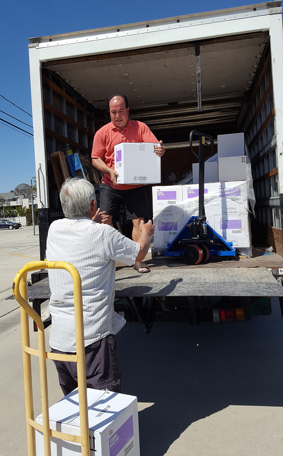 03/27/2018 Pastor Azad and Roger still busy working on unloading but the end is near