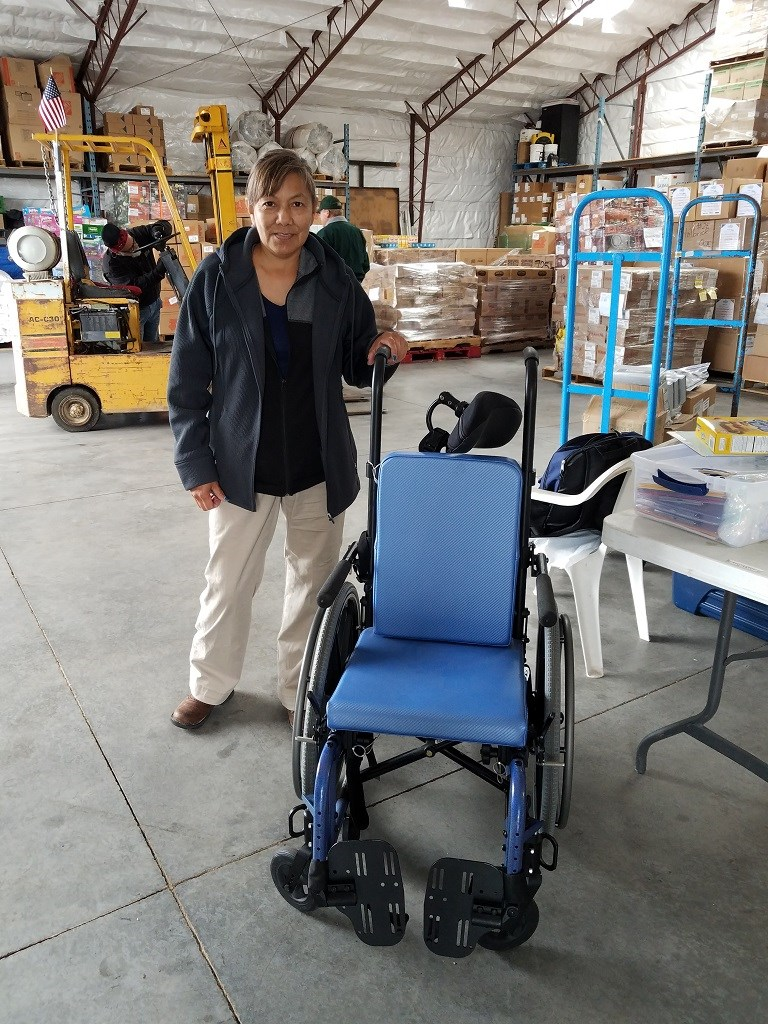 10/25/18 Bread of Life - Grandmother picking up special needs wheelchair