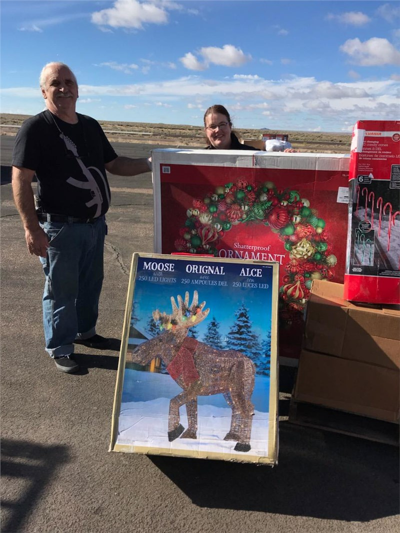 10/24/2018 Native American Christian Academy - Taking large Christmas items. The wreath was the same size as a pallet!