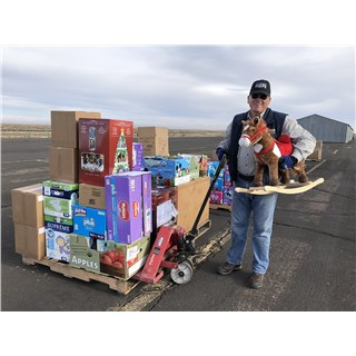 10/24/18 Catholic Charities load - Randy holding rocking horse that was wanted by many