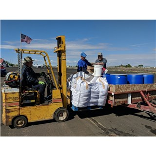 5/9/2019 - Forgotten People - Loading Pinto beans into blue barrel