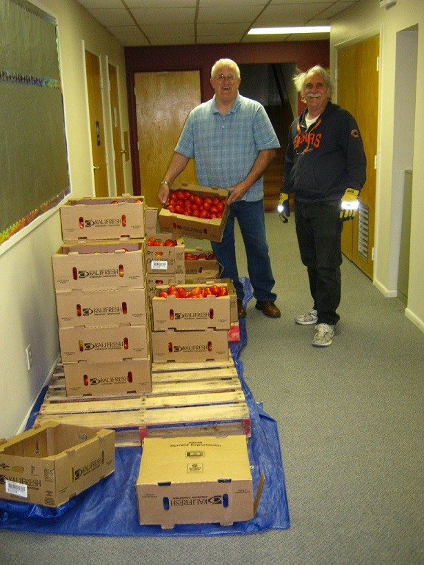 Pastor Jim Minnick and Eric Luhmann of First Southern Baptist Church of Holbrook provided a trailer load of tomatoes and potatoes