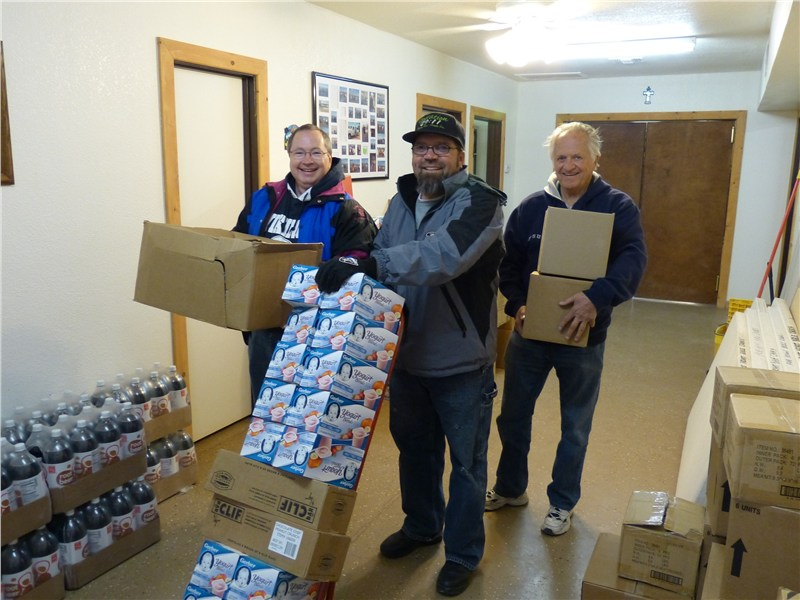 Pastor Fitz, Rich and Doug unloading supplies at Pure Heart Bible Church in Kaibeto AZ