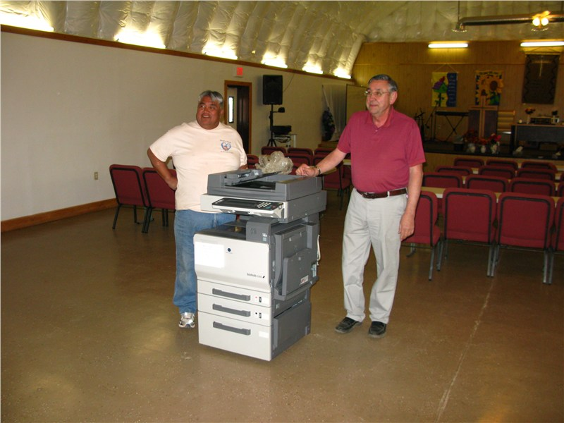 Pastor Stan checking out his new multi-function system provided by our partner 1st Free Ewaste Removal… and Nat Miller for his technical expertise is setting up the unit