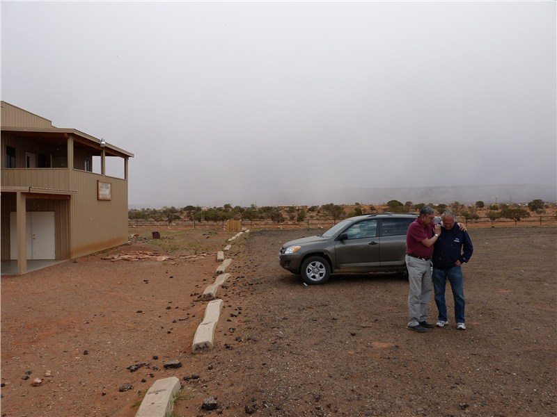 Pastor Stan praying with Doug prior to our departure for California… that is snow approaching Kaibeto in the background