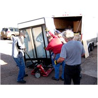 Unloading the refrigeration unit provided by Serve-One for the Holbrook warehouse