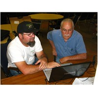 Rich introducing Pastor Jack Townsend of McNary Apache Baptist Church to his 'new' laptop computer
