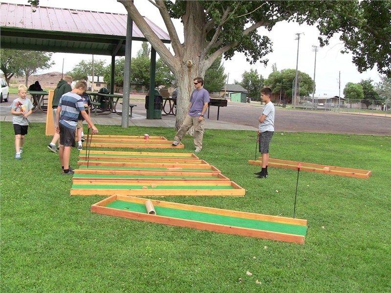 Mike and the guys setting up the miniature golf equipment
