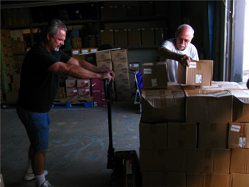 Dave and Leonard unloading school supplies for Wings of Faith