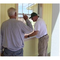 Bill instructing Randy on how to paint trim