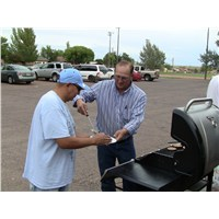 Pastor Donnie serving a sausage burger